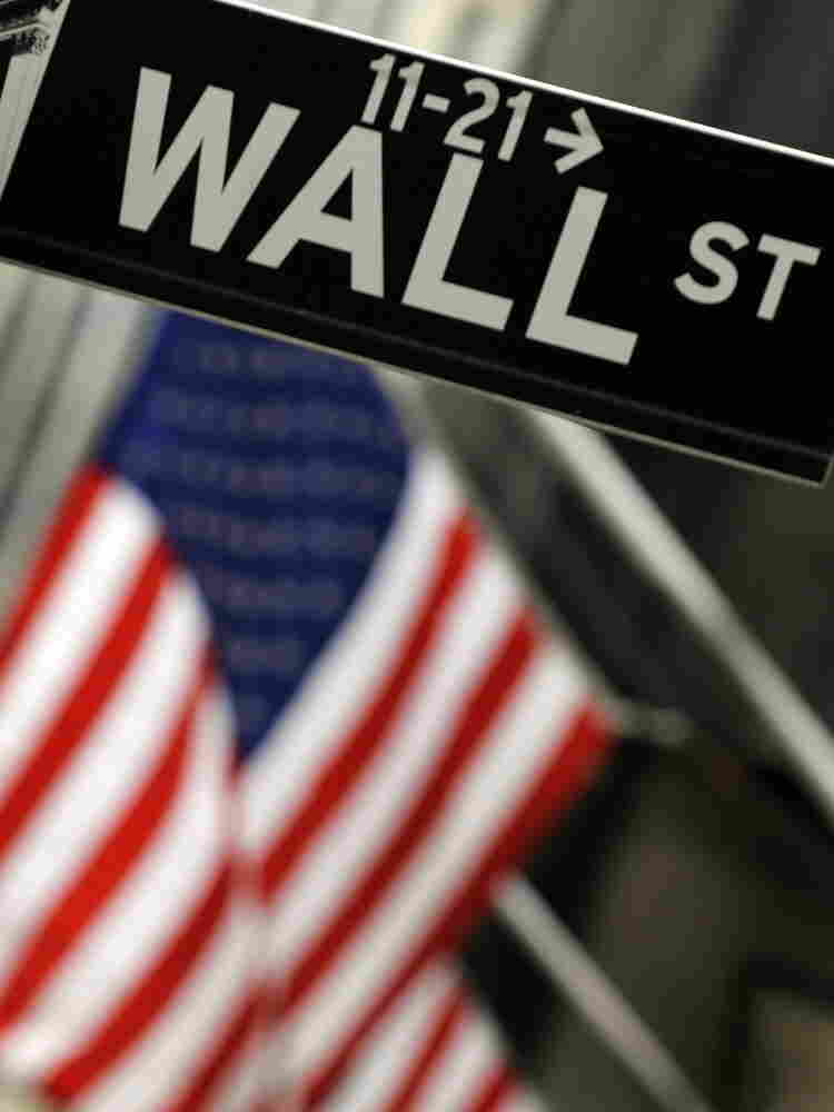 A sign for Wall Street is seen before the opening bell of the New York Stock Exchange. Though banks have recovered slightly since the 2008 financial crisis, the echoes of the crisis still resonate in a struggling U.S. economy.
