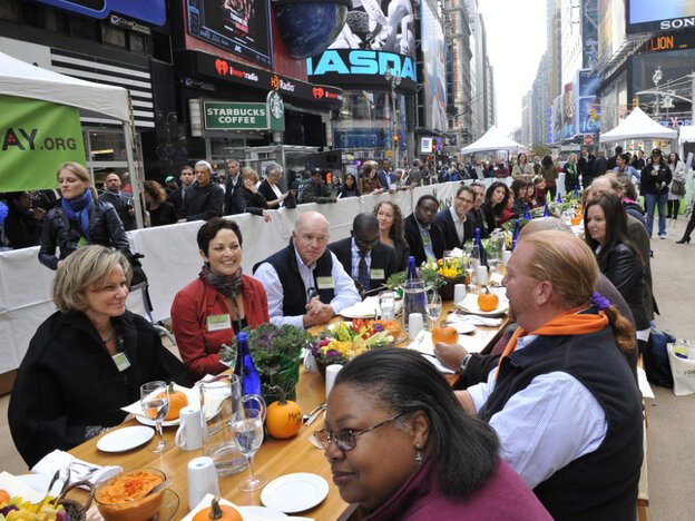 """Participants, including Mario Batali, right, at the """"Eat In,"""" a Food Day lunch event in Times Square in New York on Monday."""