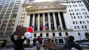 Occupy Wall Street participants demonstrate in front of the New York Stock Exchange in September. The group's press team says the point of the protests is to address the public and not CEOs, whose headquarters have left Wall Street.