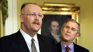 Joe Allbaugh, left, speaks to the press in Austin, Texas, in this Jan. 4, 2001, photo after being named as director of the Federal Emergency Management Agency by then President-elect George W. Bush.