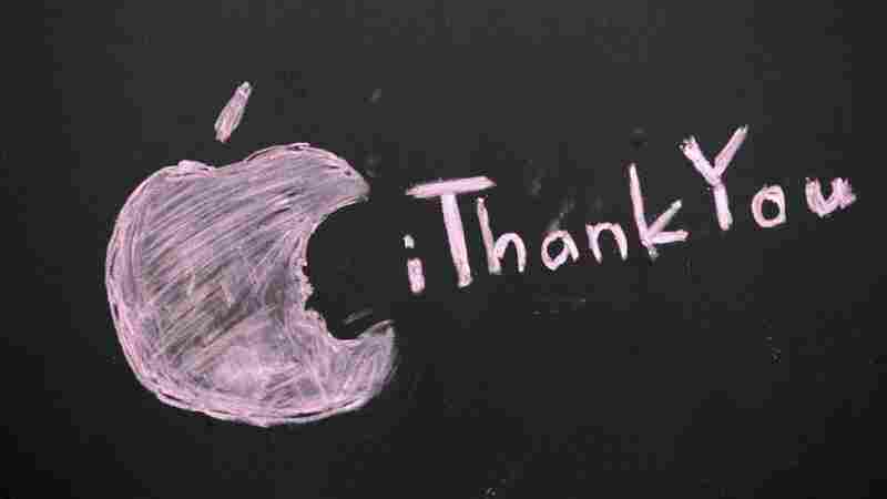 A message honoring Steve Jobs is scrawled on a blacked-out window at an Apple store in Seattle.