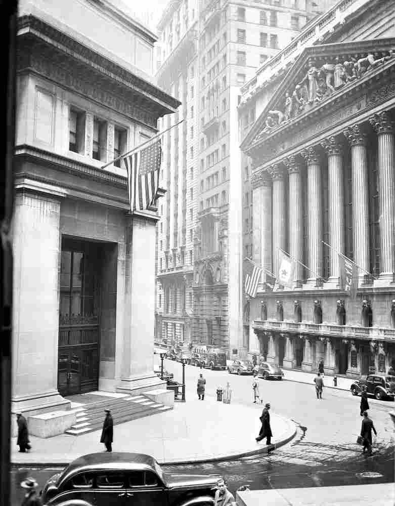 """The """"House of Morgan,"""" pictured at left in 1943, was built in 1914 to house the offices of J.P. Morgan and Co. The building was developed into condominiums beginning in 2004, and J.P. Morgan's headquarters are now located in midtown Manhattan."""