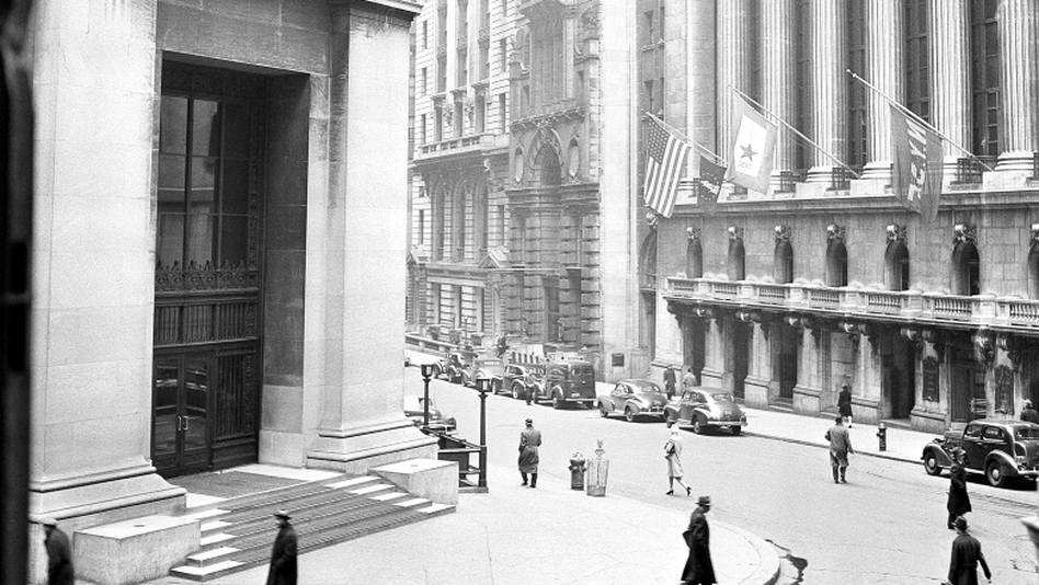 "<p>The ""House of Morgan,"" pictured at left in 1943, was built in 1914 to house the offices of J.P. Morgan and Co. The building was developed into condominiums beginning in 2004, and J.P. Morgan's headquarters are now located in midtown Manhattan.</p>"