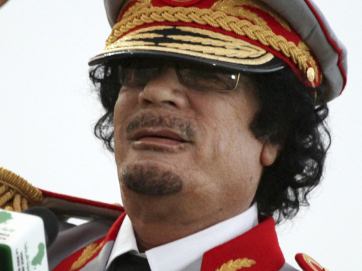 Libyan leader Moammar Gadhafi talks during a ceremony to mark the 40th anniversary of the evacuation of the American military bases in the country, in Tripoli, Libya.