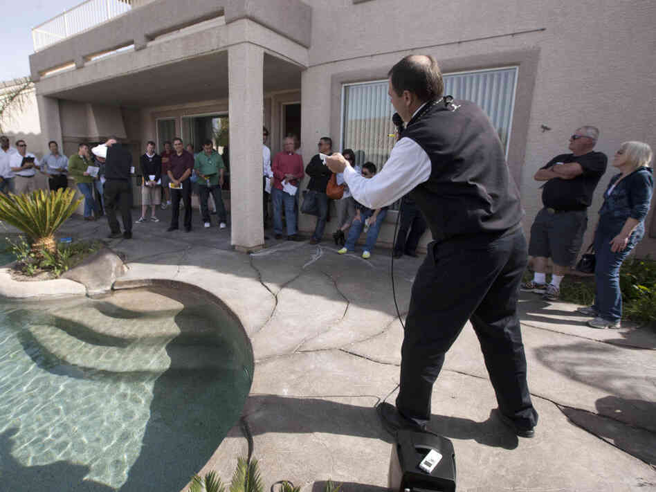 Auctioneer Eddie Burks calls out bids during a foreclosure auction in Las Vegas, April 2011.