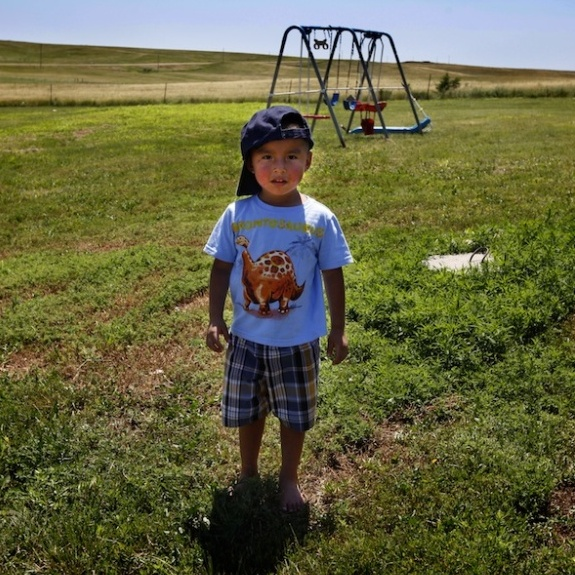 Janice Howe's grandchild Derrin Yellow Robe, 3, stands in his great-grandparents' back yard on the Crow Creek Reservation in South Dakota. Along with his twin sister and two older sisters, he was taken off the reservation by South Dakota's Department of Social Services in July of 2009.