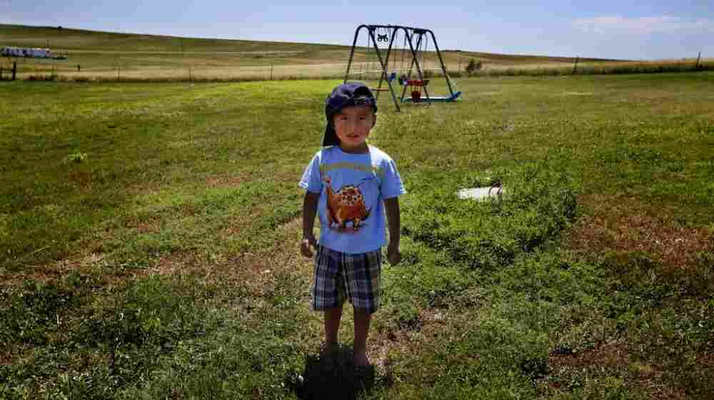 Derrin Yellow Robe, 3, stands in his great-grandparents' backyard on the Crow Creek Reservation in South Dakota. Along with his twin sister and two older sisters, he was taken off the reservation by South Dakota's Department of Social Services in July 2009 and spent a year and a half in foster care before being returned to his family.