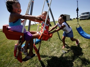Janice Howe's grandchildren, from left, Daylyn, 3, Rashauna, 6, and Antoinette, 8, play on the Crow Creek Reservation. The children were taken off the reservation by South Dakota's Department of Social Services for a year and a half after a social worker heard an unsubstantiated rumor about their mother's possible abuse of prescription pills. Their mother was never charged with anything.