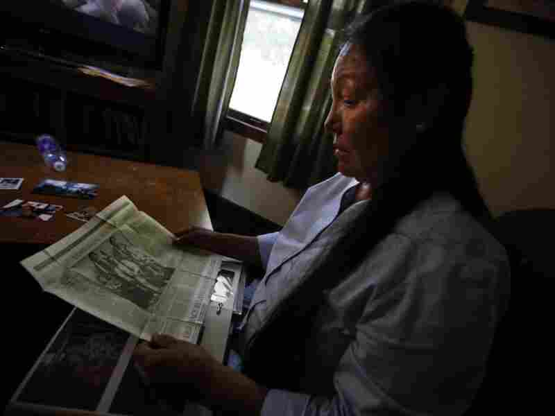 Suzanne Crow looks through a family photo album at her home in Sioux Falls, S.D., and comes across an old newspaper clipping of Sitting Bull, a Hunkpapa Lakota like herself.