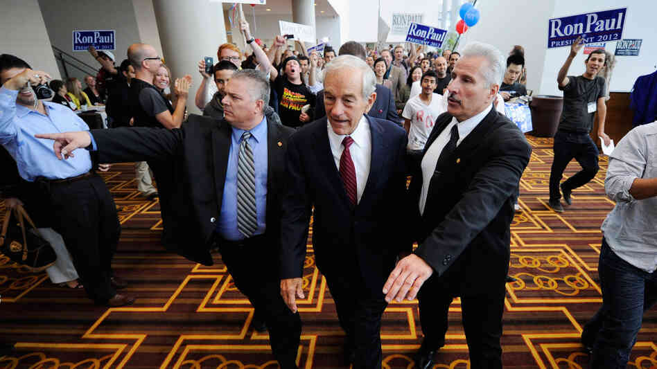 Republican presidential candidate Ron Paul is escorted to a ballroom to speak to his supporters during the California Republican Party Convention this September in Los Angeles. The Texas congressman was once a small-town doctor who specialized in delivering babies.
