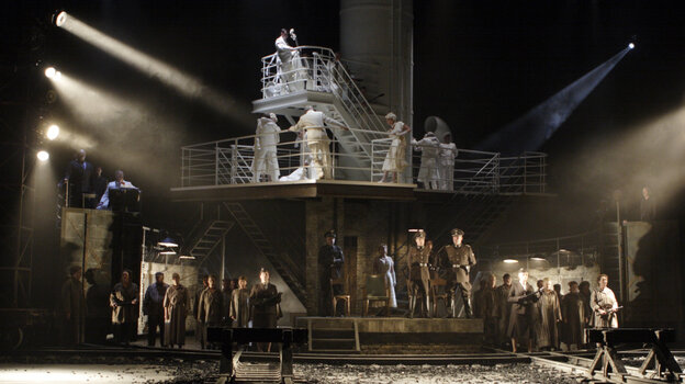 The Passenger is staged to juxtapose Auschwitz during the Holocaust — on the lower stage — with a chance encounter on the upper level years later.