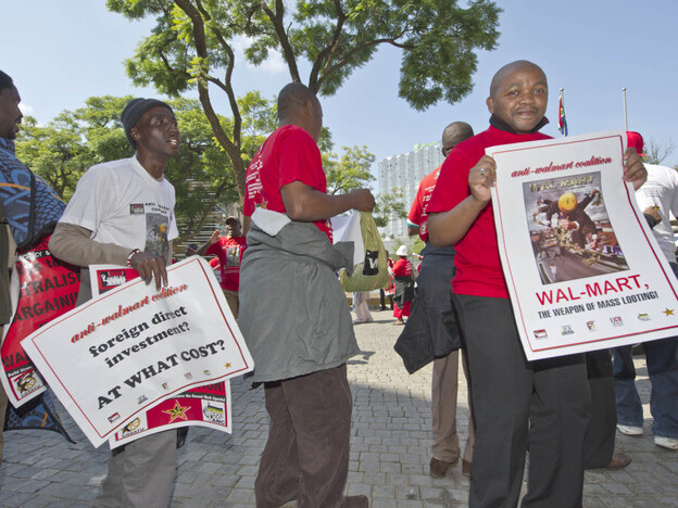 <p>Members of the South African Commercial, Catering and Allied Workers Union protest against Walmart's acquisition of Massmart, southern Africa's largest retailer, in May. The deal was initially approved but is now under review.</p>