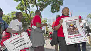 Members of the South African Commercial, Catering and Allied Workers Union protest against Walmart's acquisition of Massmart, southern Africa's largest retailer, in May. The deal was initially approved but is now under review.