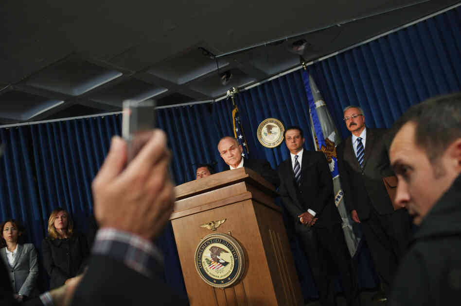 U.S. Attorney for the Southern District of New York Preet Bharara speaks as New York City Police Commissioner Raymond Kelly and Charles Campisi, head of internal affairs, listen during a news conference Tuesday to announce the arrest of five New York Police Department officers on charges that th