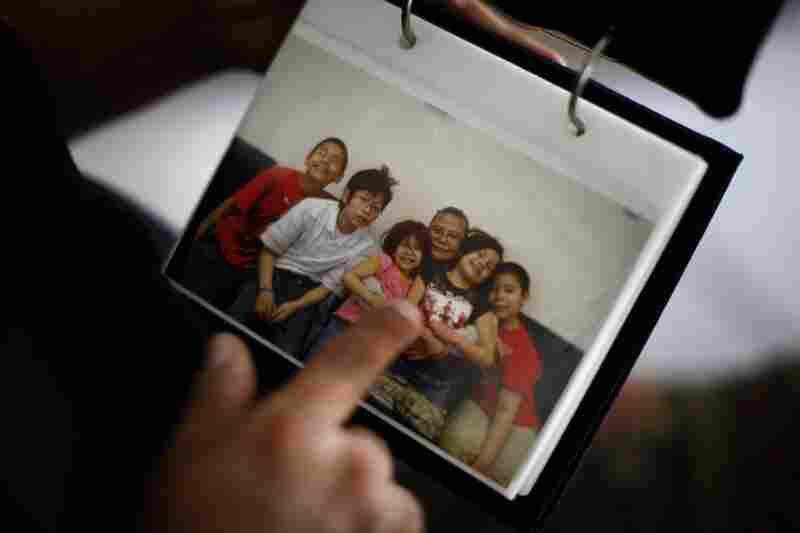 Here, Thunder points to a picture of her grandchildren that was taken during one of her monthly visits. From left are: Jason Martinez, Jr., Ryan Uses the Knife, Janae, Lois Thunder, Angel and Jayden.