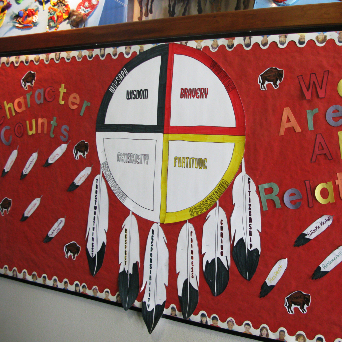 Children's artwork lines the halls of the Children's Home Society in South Dakota. Officials there say they try to keep Native American kids connected to their culture.