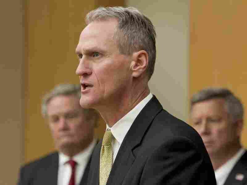 South Dakota Gov. Dennis Daugaard, seen here at a news conference in October, spent seven years in leadership positions at Children's Home Society before becoming the state's governor.