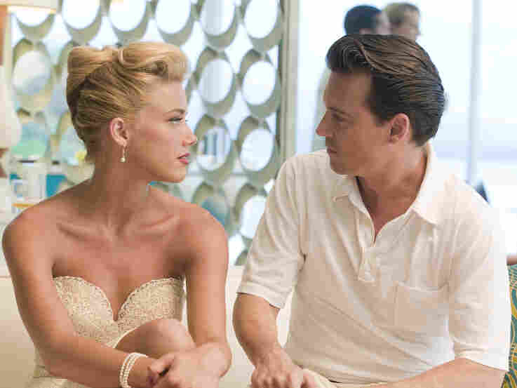 Flirtatious beauty Chenault (Amber Heard) catches Kemp's eye when he visits the beachfront mansion of a local businessman.