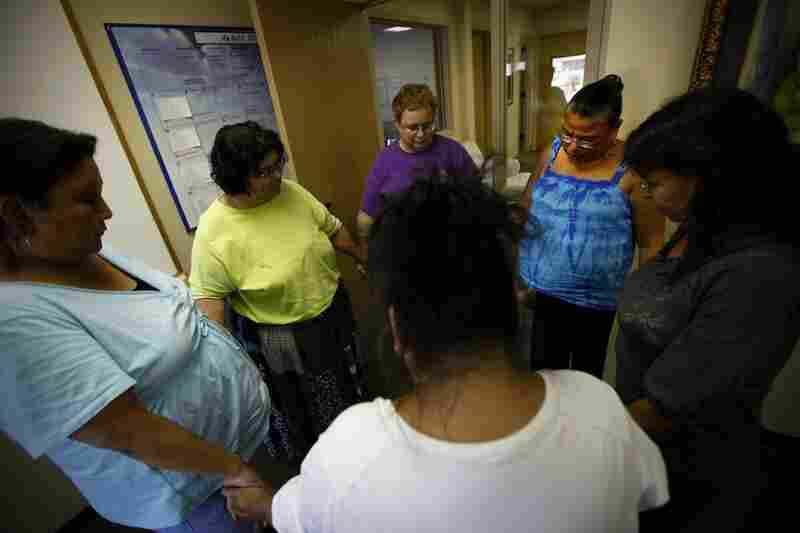 Members of the Sioux Falls 'Grandmother's Group,' join in a group prayer at the end of their weekly meeting.  They meet to commiserate and help support each other as they try to get their grandchildren back from state custody. Clockwise from left are: Delores Highpine, Vernaline Gogue, Linda Herzberg, Lois Thunder, Marilyn Lone Hill and Edie LaRoche-Provencial.