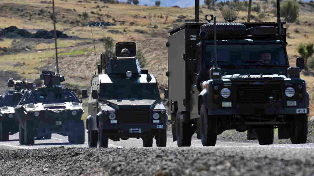 A convoy of Turkish army vehicles drives along a road in the province of Sirnak, near the Turkish-Iraqi border. The conflict between Turkey and Kurdish militants in northern Iraq has intensified in recent weeks.
