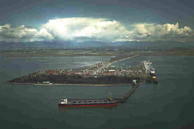 The port in Vancouver juts out into the Strait of Georgia on an artificial island. Wind kicks up coal particles from open conveyors and coal piles, and carries it out to sea. The port is currently undergoing a $5 million renovation to help mitigate that. The proposed port in Bellingham, backers say, will be more environmentally friendly.