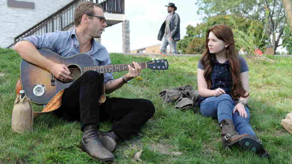 Suddenly, A Duet: Rocker Ethan (Alessandro Nivola, left) discovers he has a teenage daughter (Abigail Breslin), when her ex-groupie mother dumps her with him on the way to rehab.