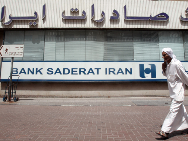 <p>A man walks past a branch of Iran's Bank Saderat in Dubai, in the United Arab Emirates. An estimated $2.6 billion has been stolen from Bank Saderat and other leading Iranian banks, causing a growing scandal.</p>