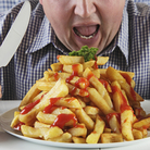 Male binge eaters were more likely to be depressed and obese than men who didn't binge, a study found.