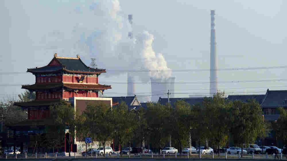 To feed China's insatiable demand for coal, U.S. companies are trying to sell and ship the lucrative commodity to the Asian market from new West Coast ports. Above, the cooling towers of a coal-fired power plant are seen on the outskirts of Beijing.