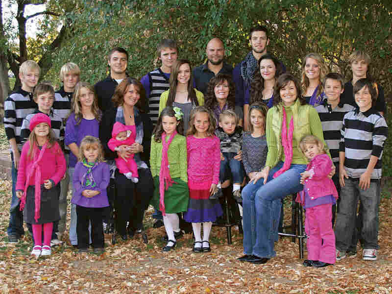Joe, Alina, Vicki and Valerie Darger are raising 23 children together. (Two children, Sam and Victoria, are not shown.)