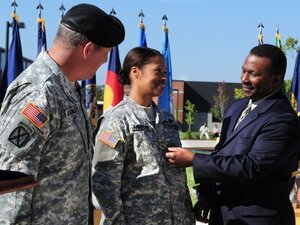 Maj. Gen. Marcia Anderson receives her second star from her husband, Amos, during a Sept. 29 ceremony at Fort Knox, Ky., while the U.S. Army Accessions Command and Fort Knox commanding general, Lt. Gen. Benjamin Freakley, looks on.