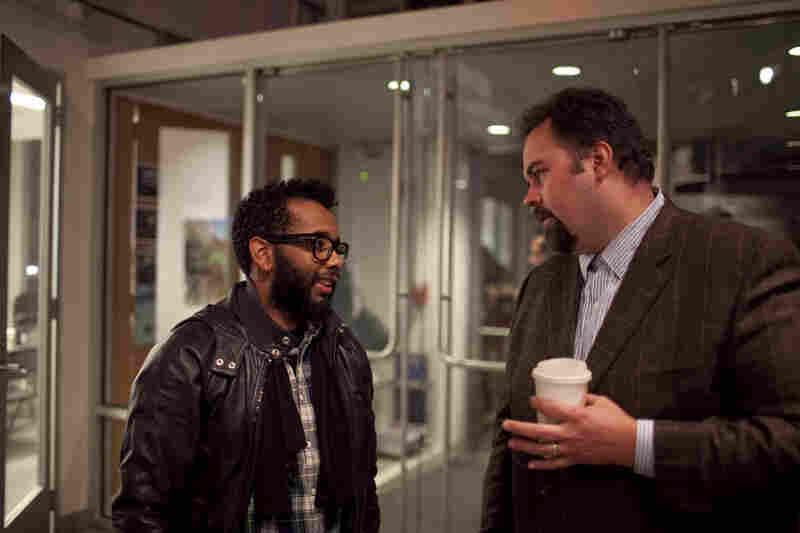 Josh Jackson speaks with drummer Jamire Williams outside the venue.
