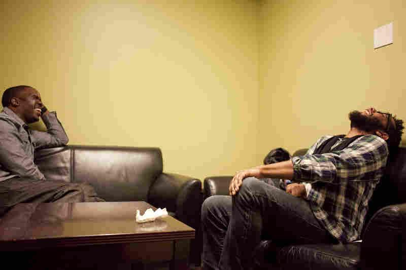 Derrick Hodge with Jamire Williams, backstage.