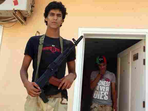 Libyan rebel fighters from the Zintan Brigade, formed by its leader Mohammed Ali Madani who died young in a battle with Moammar Gadhafi's forces, gather in a compound in Tripoli on Sept. 6, 2011.