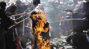 Protesting Yemeni women burn their veils, during a demonstration demanding the resignation of Yemeni President Ali Abdullah Saleh in Sanaa, Yemen.