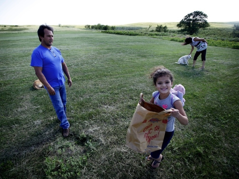<p>Dwayne Stenstrom and his wife, Rose, live on South Dakota's Rosebud reservation, where they raised six children. Also pictured is their granddaughter.</p>