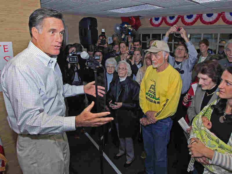 Former Massachusetts Gov. Mitt Romney speaks to a group of supporters during a visit Tuesday to a GOP phone bank in Terrace Park, Ohio.