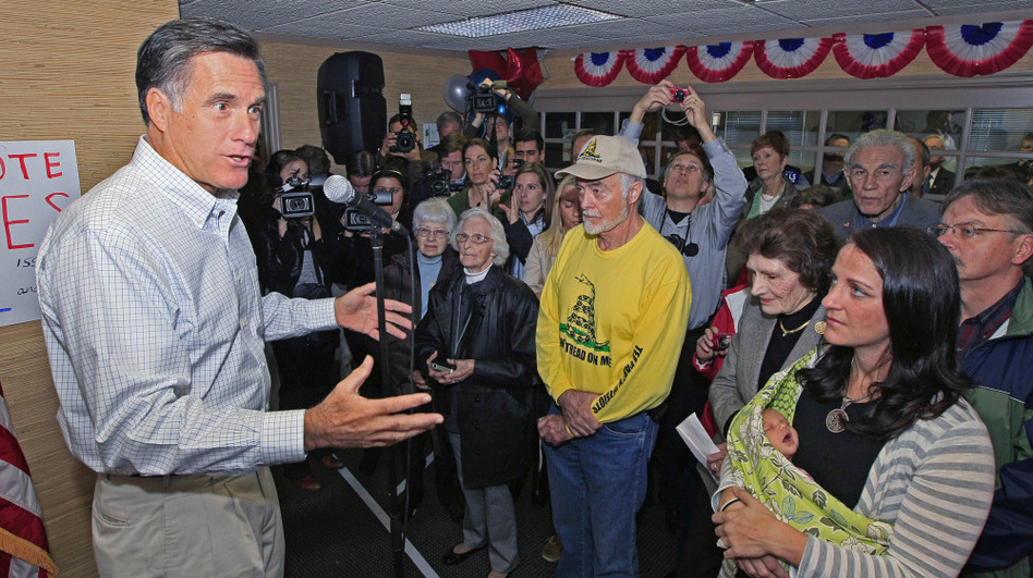 Former Massachusetts Gov. Mitt Romney speaks to a group of supporters during a visit Tuesday to a GOP phone bank in Terrace Park, Ohio.  (AP)