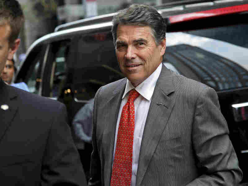 Texas Gov. Rick Perry arrives at Trump Tower in New York for a meeting with real estate developer Donald Trump in September.