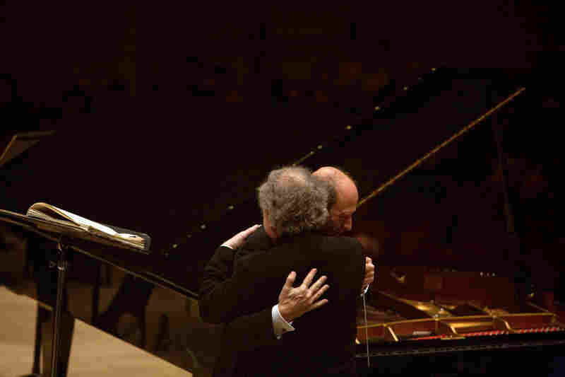 A heartfelt hug between two old friends onstage at Carnegie Hall.