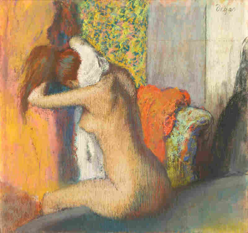 Many of Degas' nudes have their backs turned to the viewer. Above, Degas' pastel work, After the Bath, Woman Drying Her Neck, 1886-95.