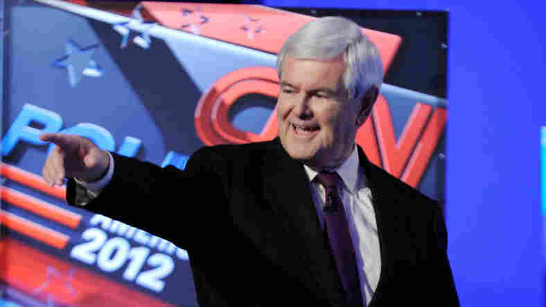 Newt Gingrich is introduced before the start of a Republican presidential debate earlier this month in Las Vegas.The former House speaker is hoping for a surge after a highly anticipated Iowa caucus poll is released this weekend.