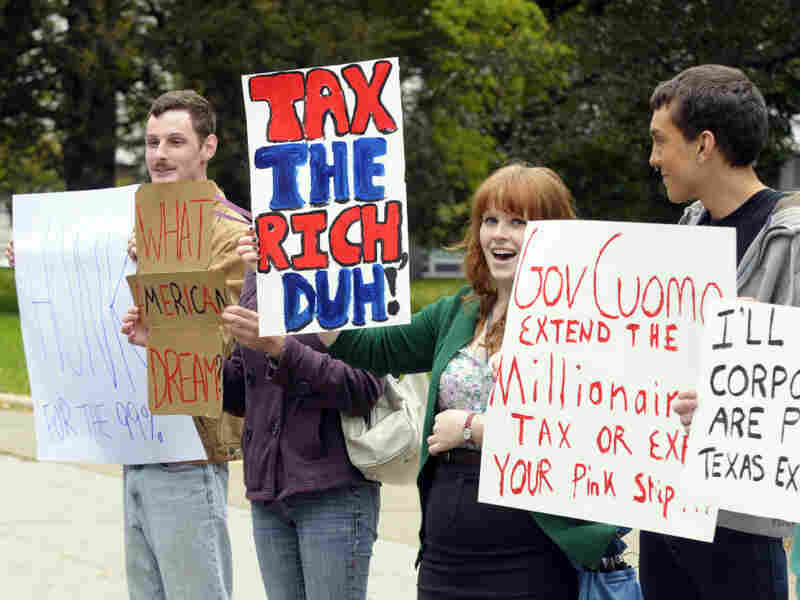 Demonstrators supporting the Occupy Wall Street movement — and an extension of the millionaires tax in New York — protest in Albany on Oct. 21.