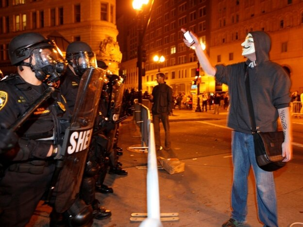 Tuesday in Oakland: An Occupy protester and police.