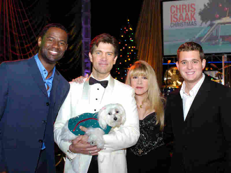 Rodney the Maltese dog in a suit made by Jaime Custom Tailors. From left to right: Brian McKnight, Chris Isaak, Stevie Nicks and Michael Buble.