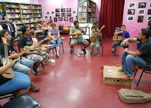 Students learn the jarana in a Son Jarocho class at Tia Chucha's Centro Cultural & Bookstore in Sylmar, Los Angeles.