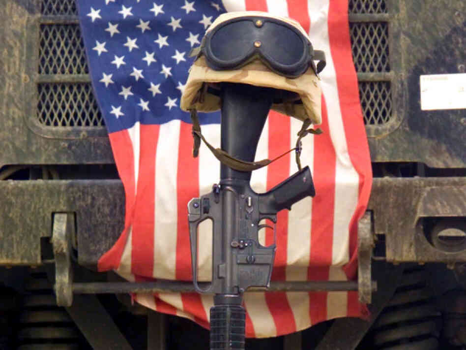 An M16-A2 service rifle, a pair of boots and a helmet stand in tribute to a fallen Marine Corps Sergeant assigned to Marine Wing Support Squadron Three Seven One (MWSS-371), killed in action in Iraq during Operation Iraqi Freedom.