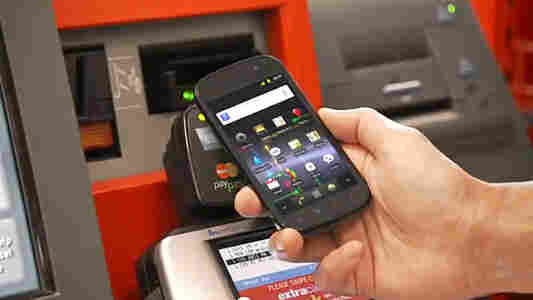 A screengrab shows the Google Wallet app being used to pay for items at a CVS store.
