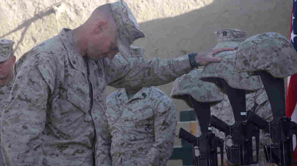 Lt. Col. Jason Morris pays his respects at a memorial service in Sangin, Afghanistan, on Nov. 26, 2010, for three Marines who were killed: Lance Cpl. Brandon Pearson, Lance Cpl. Matthew Broehm and 1st Lt. Robert Kelly. Morris commanded a battalion in volatile Helmand province that suffered the highest casualty rate of any Marine unit in the Afghanistan War.