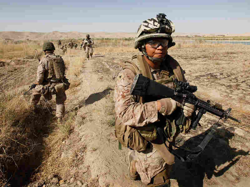 Cpl. Marcus Chischilly patrols near Forward Operating Base Zeebrugge in October 2010, near Kajaki, Afghanistan. This photo was taken a day before he stepped on an IED, losing his left leg and suffering other shrapnel damage.